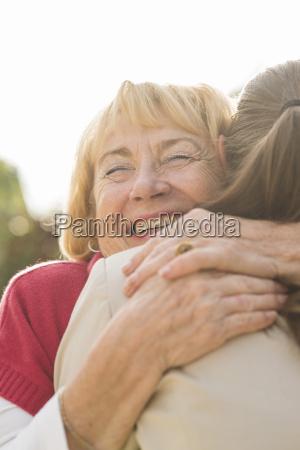 portrait of happy senior woman hugging
