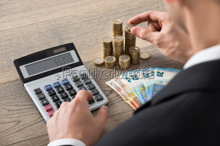close up of a businessman calculating