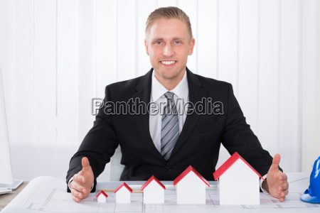 young male architect working on blueprints
