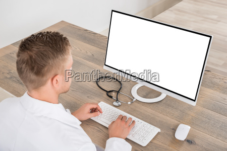 male doctor using computer