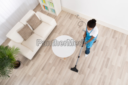 african female janitor cleaning floor