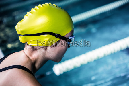 swimmer about to dive in pool