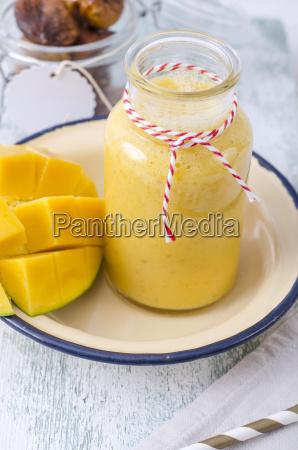 mango smoothie in glass bottle