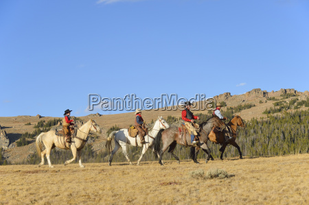 usa wyoming four riding cowboys