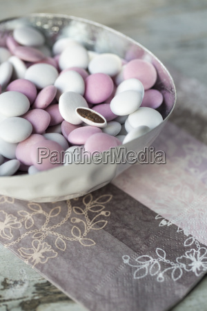 bowl of white and pink chocolate