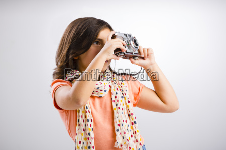 little girl taking a photo