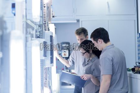 students at electronics vocational school looking