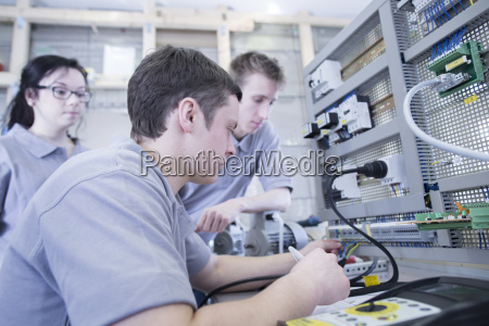 students at electronics vocational school