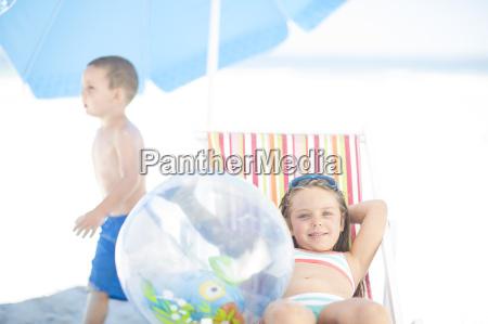 smiling girl on beach relaxing on