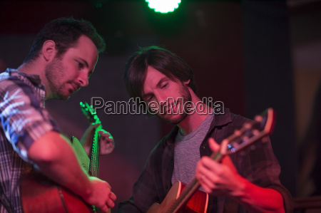 two acoustic guitar players