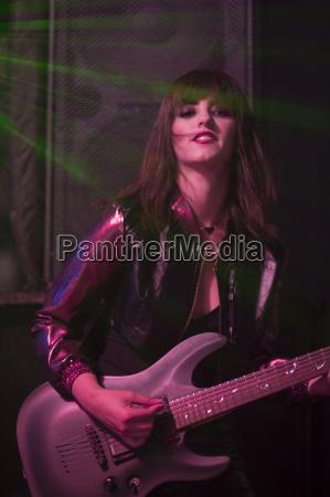 portrait of female rock guitar player