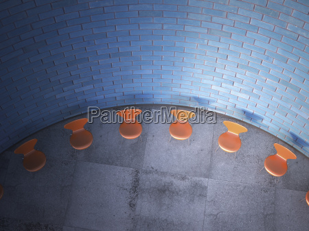 chairs arranged in a circle in