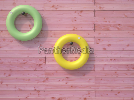 two floating tires hanging on pink