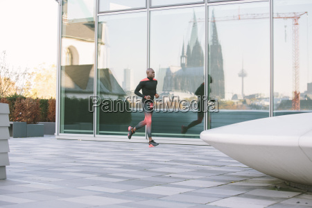 germany cologne athlete running at glass