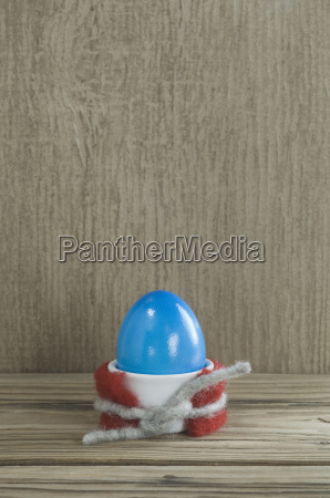 egg cup with blue easter egg