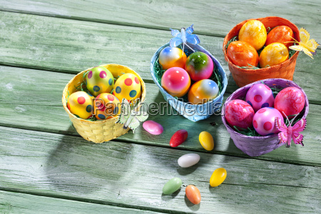 four easter nests with coloured easter