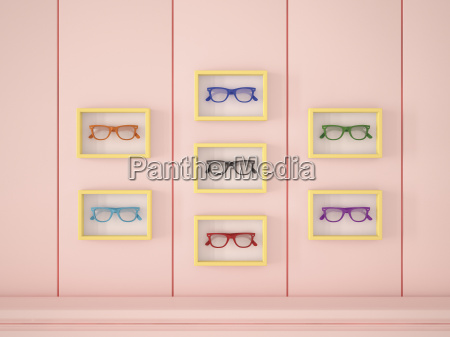colourful glasses in yellow frames hanging
