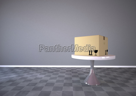 cardboard box on a round table