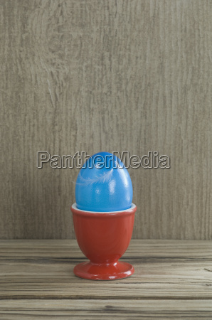 red egg cup with blue easter