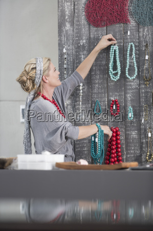 woman hanging bead necklace stock on