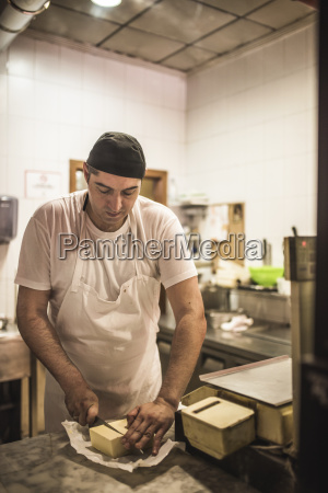 experienced pizza baker preparing dough for
