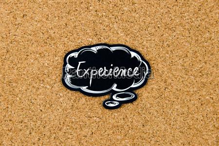 experience auf schwarzer denkblase geschrieben