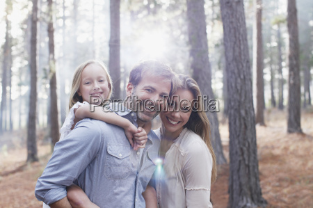 portrait of smiling family in sunny