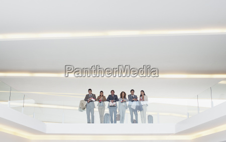 portrait of business people standing at