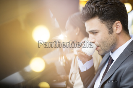 businessman at sidewalk cafe