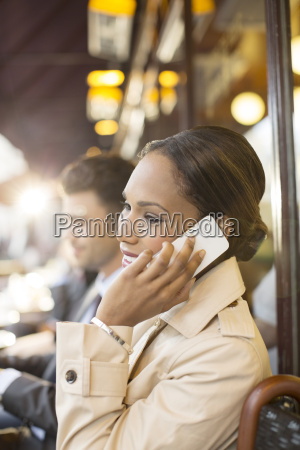 businesswoman on cell phone at sidewalk