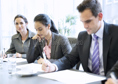 portrait of smiling businesswoman in meeting