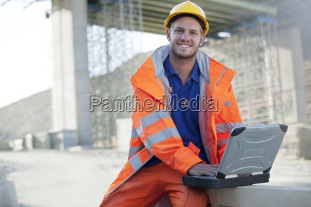 worker using laptop on site
