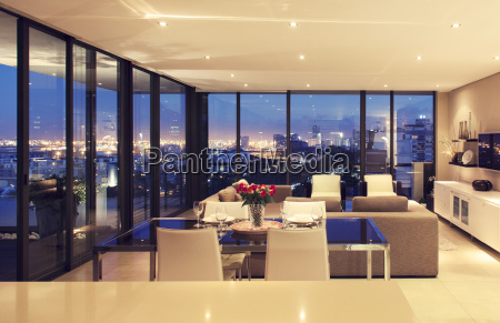 illuminated modern living room overlooking city