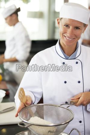 chef baking in restaurant kitchen