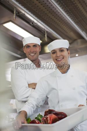 chefs smiling in restaurant kitchen