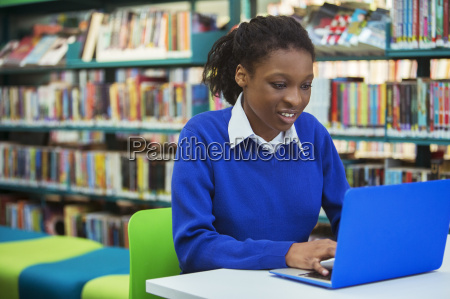busy female student with laptop in