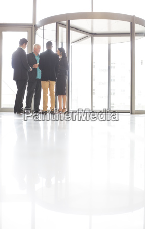 business people standing and talking near