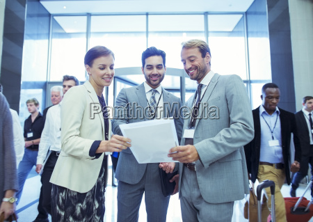 portrait of businesswoman and two businessmen