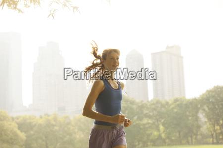 woman running in urban park
