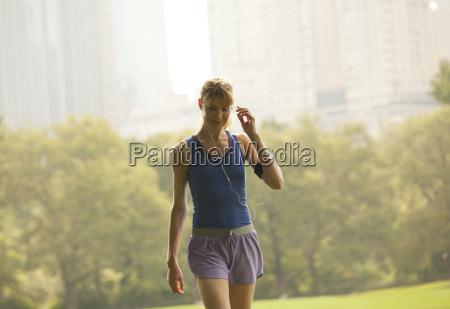 runner walking in urban park