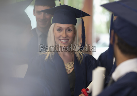 female student smiling in graduation clothes