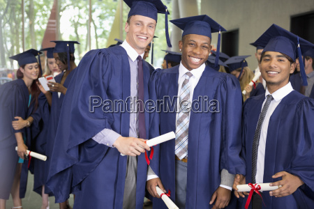 portrait of three smiling male students