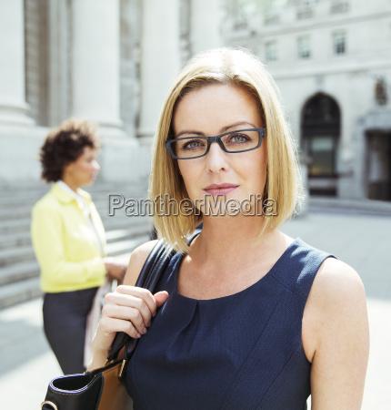 businesswoman standing in city