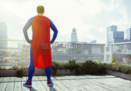superhero looking at view from city