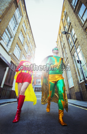 low angle view of superhero couple