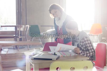 creative businesswomen reviewing document edits in