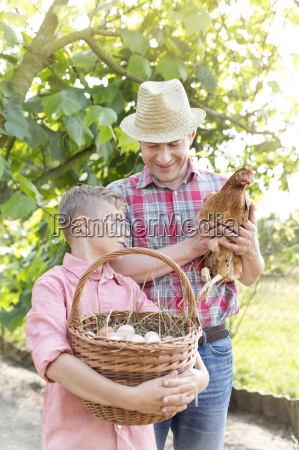 father and son with chicken and