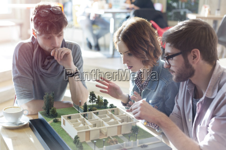 architects brainstorming at building model in