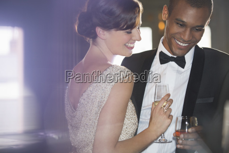 well dressed couple drinking champagne and