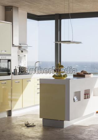 modern kitchen overlooking ocean